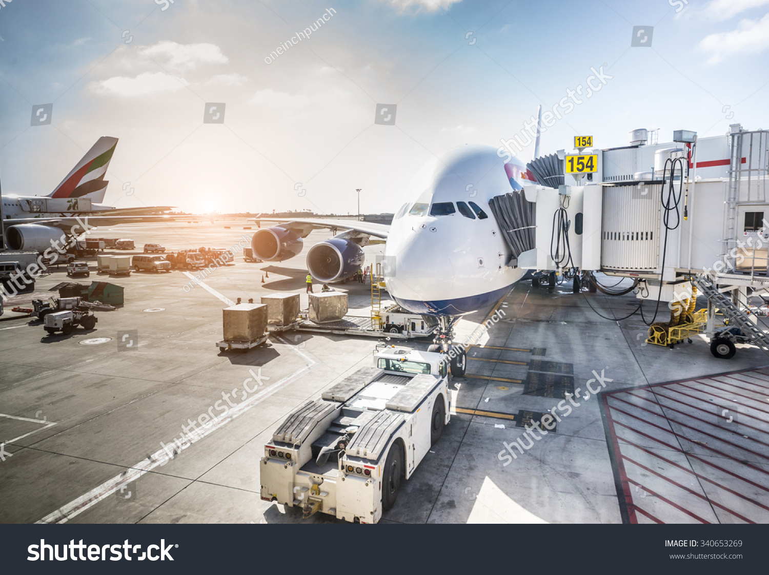 stock-photo-airplane-ready-for-boarding-in-a-airport-hub-340653269